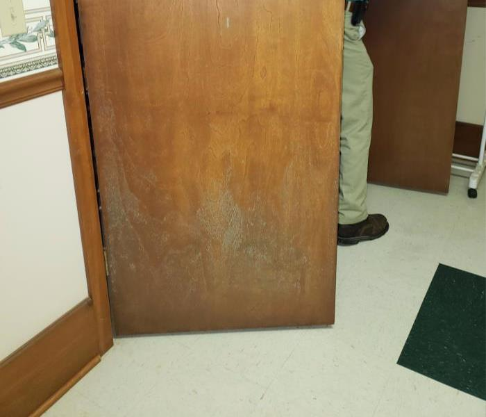 A door in city hall building with mold on it's surface